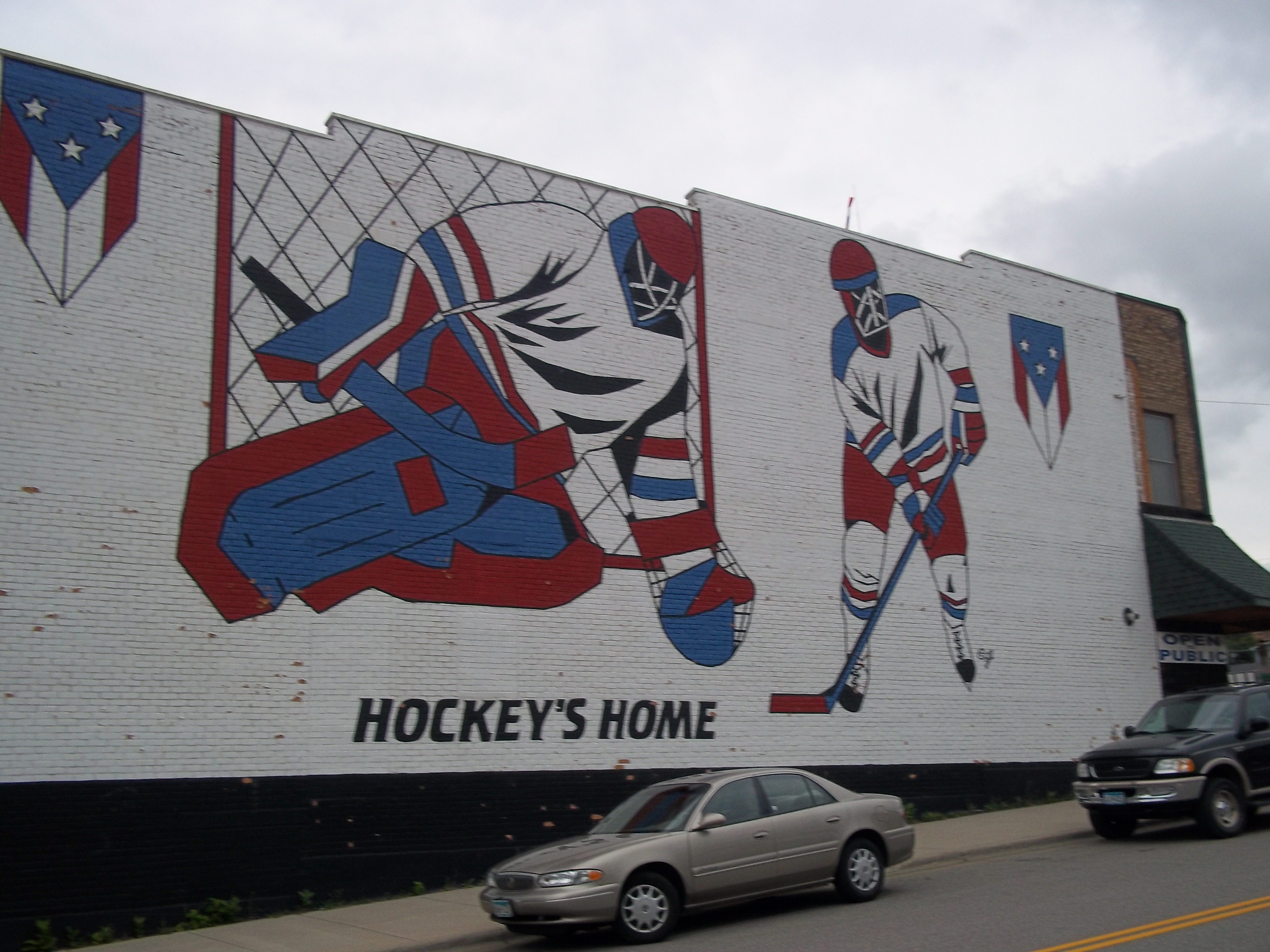 world s largest hockey stick puck eveleth mn also here in eveleth just across the street from the colossal piece of sports equipment is the united states hockey hall of fame